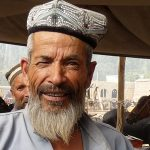 8 sourire P1080005ba Kashgar
